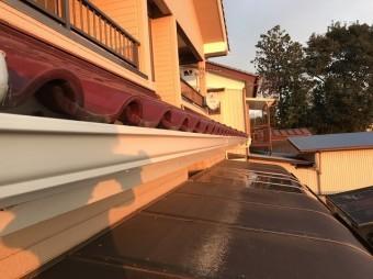夕日に映える交換完了の軒樋