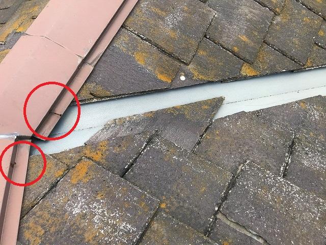 台風被害を受けてスレート屋根の釘抜けが起きている