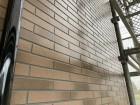 クリアー塗装を施し艶がよみがえったタイル調の外壁サイディング